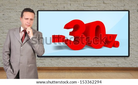 businessman thinking and plasma panel with discount on wall - stock photo