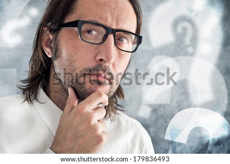 Businessman thinking and questioning. Portrait of thoughtful business person.