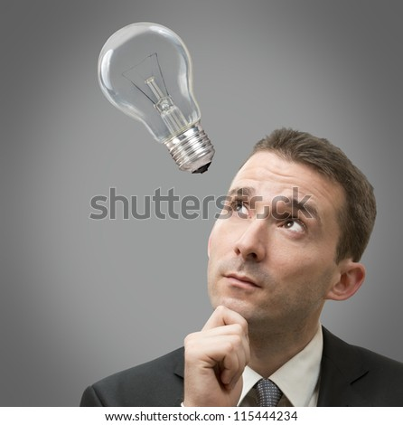 Businessman thinking concept with a light bulb of - stock photo