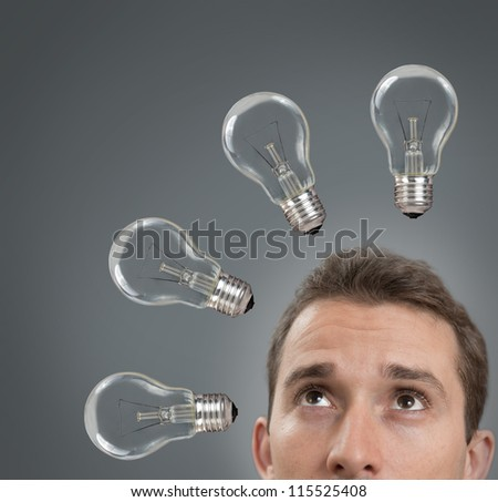Businessman thinking concept with a light bulbs of - stock photo