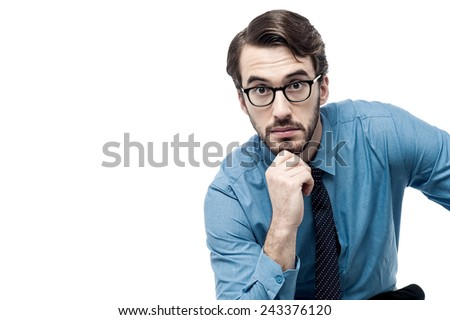 Businessman thinking deeply with hand on chin - stock photo