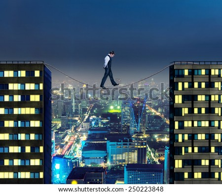 Businessman thinking going the tightrope - stock photo