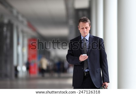businessman thinking law on the cell phone - stock photo
