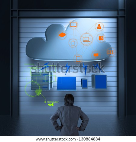 Businessman thinking of a Cloud Computing diagram on the new computer as concept - stock photo