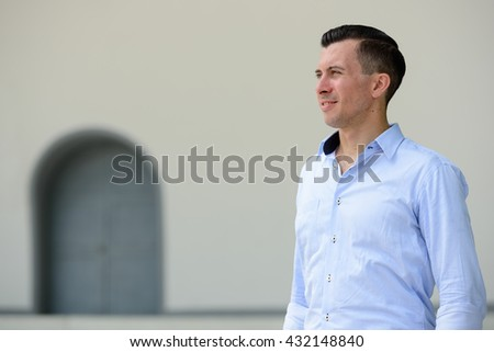 Businessman thinking outdoors