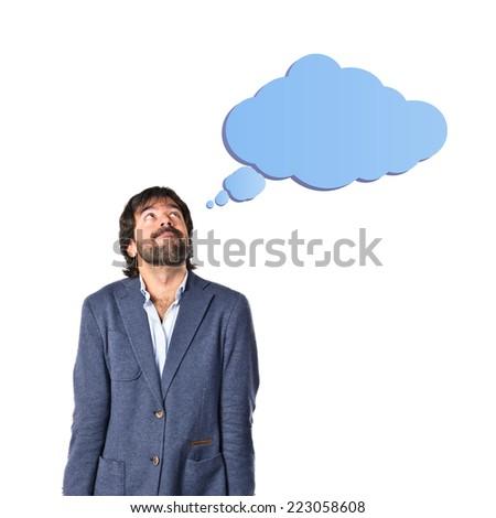 Businessman thinking over isolated white background - stock photo