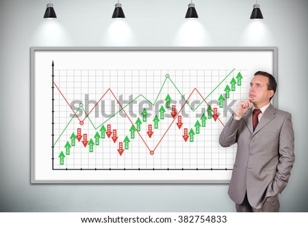 businessman thinking standing near plasma panel with stock chart