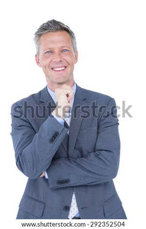 Businessman thinking with hand on chin against a white background - stock photo