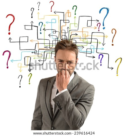 Businessman thinks of solutions for his doubts - stock photo