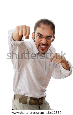 Businessman throwing a punch. Isolated on white.