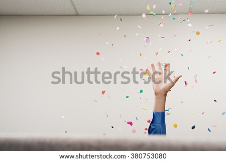 Businessman throwing confetti in the air - stock photo