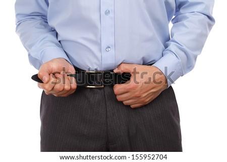 Businessman tightening his belt concept for recession or economic depression - stock photo