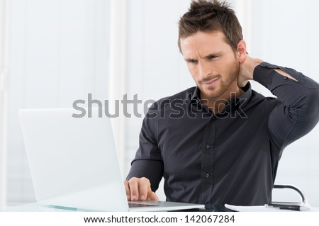 Businessman Tired Working On Laptop - stock photo