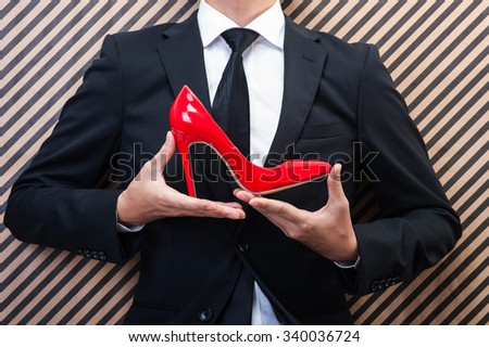 Businessman to have red high heels