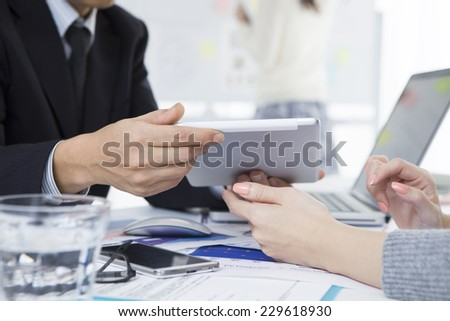 Businessman to meetings using electronic tablet - stock photo