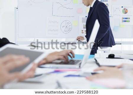 Businessman to presentation in white board - stock photo