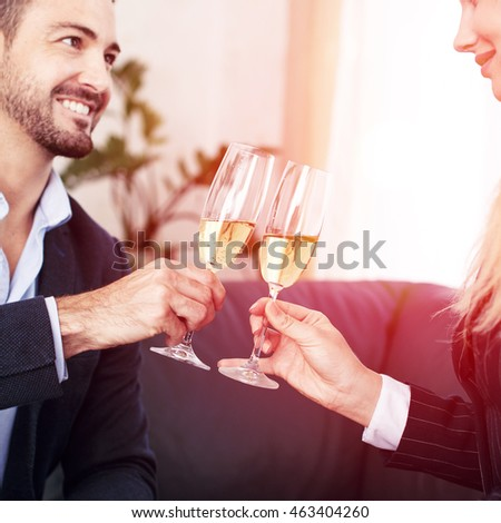 Businessman toast with businesswoman in office closeup
