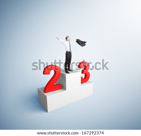 businessman took first place on the podium - stock photo