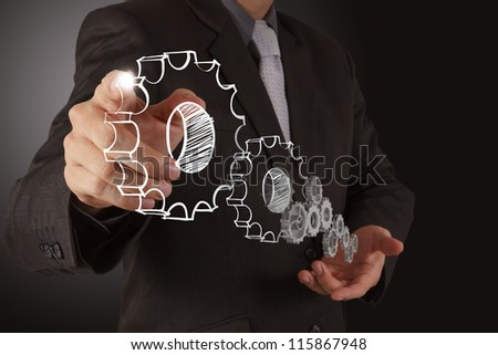 businessman touch gear to success concept - stock photo
