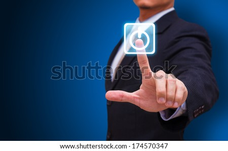 Businessman touch on power button