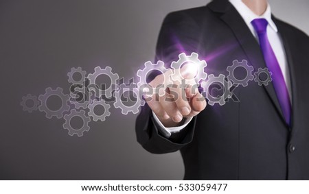 Businessman touch screen concept - Gears