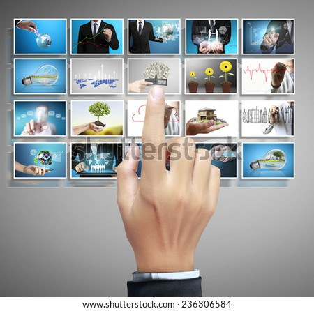 Businessman touch screen to choose digital photos - stock photo
