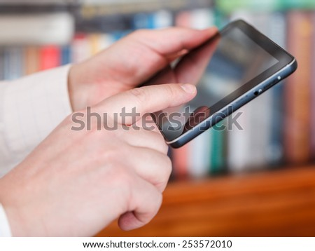 businessman touch tablet pc screen in office room - stock photo