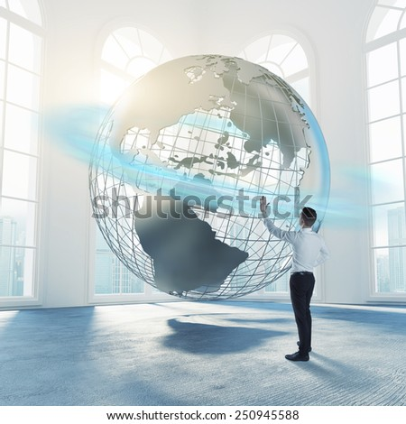 Businessman touch the globe concept - stock photo