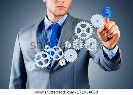 businessman touch the mechanism, run a successful business concept