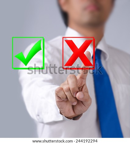 Businessman touches of the button wrong in front - stock photo