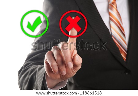 businessman touches of the button wrong in front of white background - stock photo