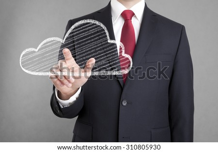 Businessman touching a cloud drawn with chalk - stock photo