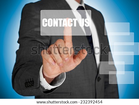 Businessman touching a contact us button - stock photo