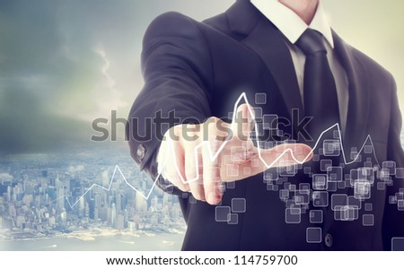 Businessman Touching a Graph above a City - stock photo