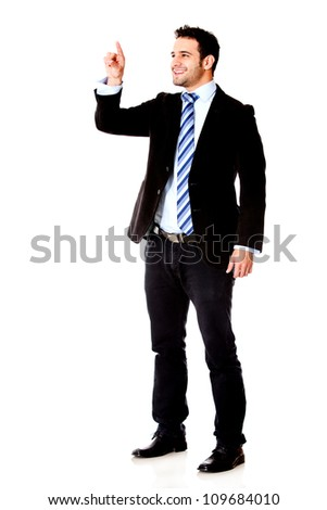 Businessman touching an imaginary screen with his finger - isolated over white background - stock photo