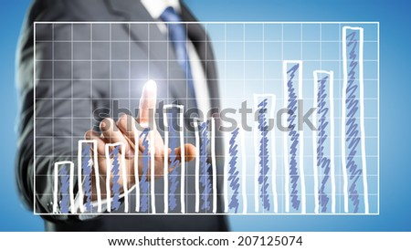 businessman touching at a chart on a screen - stock photo