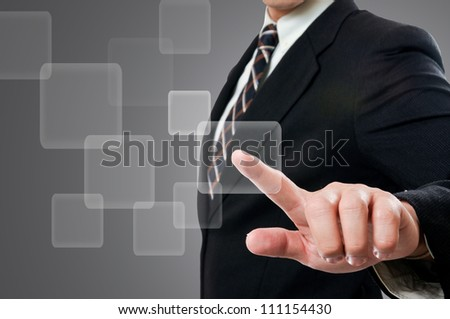 Businessman touching button - stock photo