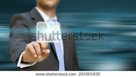 Businessman touching digital interface with his fingers - stock photo