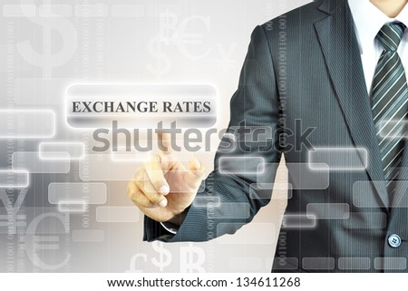 Businessman touching Exchange Rate sign. - stock photo