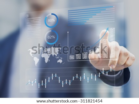 Businessman touching financial dashboard with key performance indicators - stock photo