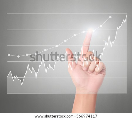 businessman Touching graph of work