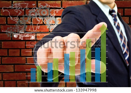 Businessman touching  graph with white background - stock photo