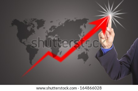 Businessman touching growing graph in studio