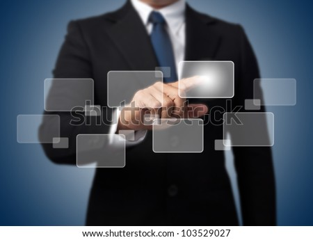 Businessman touching high tech type of modern buttons on a virtual background