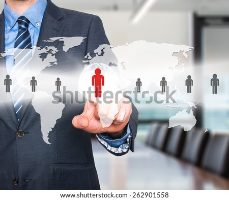 Businessman touching human resources sign - HR, HRM, HRD concept. World Map. Isolated on office background.  - stock photo