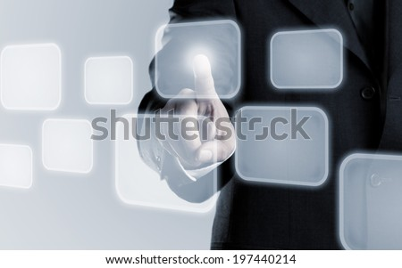 Businessman touching infogram graphics on virtual touchscreen with copy space - stock photo