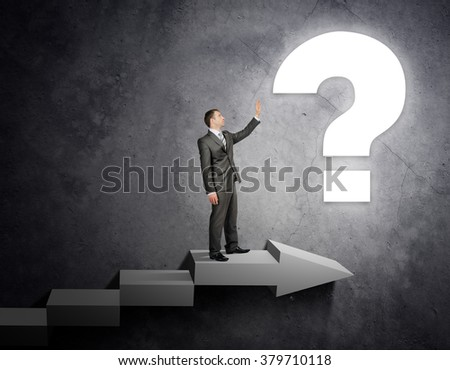 Businessman touching question sign