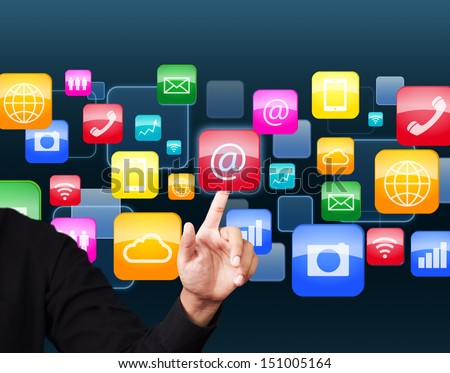 Businessman touching social application icon - stock photo