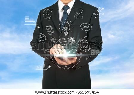 Businessman touching tablet analysis strategy plan the future. - stock photo