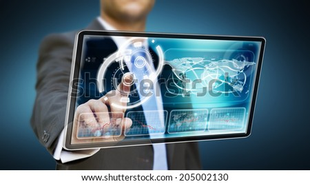 Businessman touching tablet multimedia with his fingers - stock photo